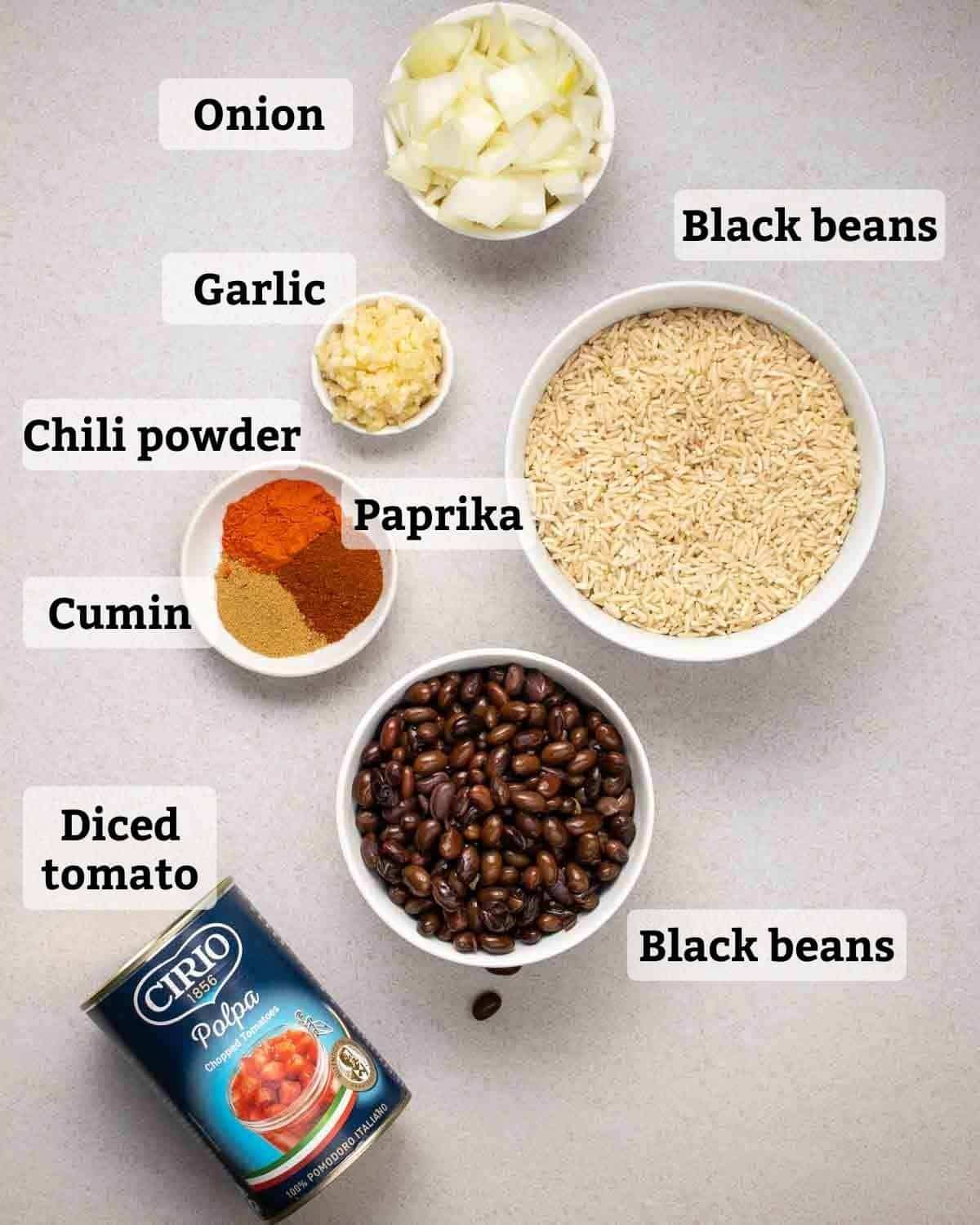 Ingredients needed like rice, beans, diced tomatoes, garlic, onion and spices.