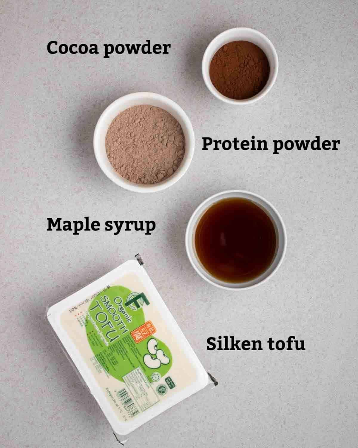 Ingredients needed like silken tofu, maple syrup, protein powder and cocoa powder.