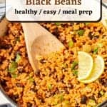 Spooning out Mexican rice from a Dutch oven with a wooden spatula with text overlay.