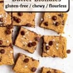 A tray of blondies on a parchment paper with text overlay.