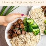 Holding a plate containing rice, broccoli and teriyaki seitan with text on the upper half.